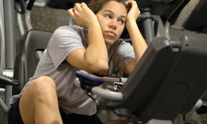 Girl bored on rowing machine