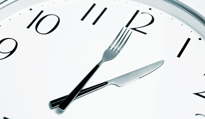 Clock with knife and fork as hands