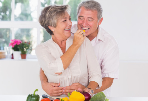 Mature couple eating in kitchen