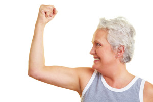 Older woman flexing muscles