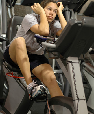 Girl bored on rowing machine
