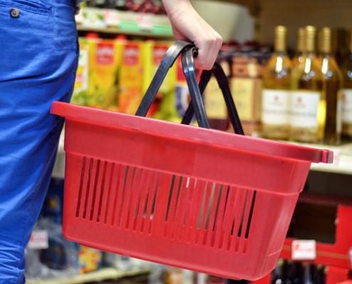 Woman carrying shopping basket