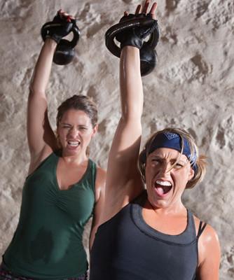 Two women training hard