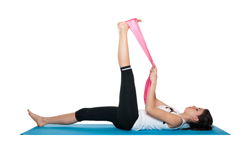 Woman stretching with resistance band