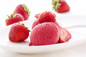 Strawberry sorbet with strawberries on white plate