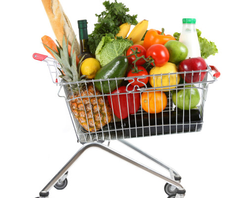 Shopping trolley full of fresh fruit and vegetables