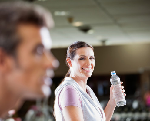 Woman smiling with water bottle