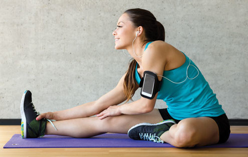 Girl-stretching-with-iPod