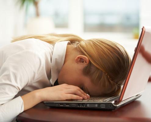 woman asleep at laptop